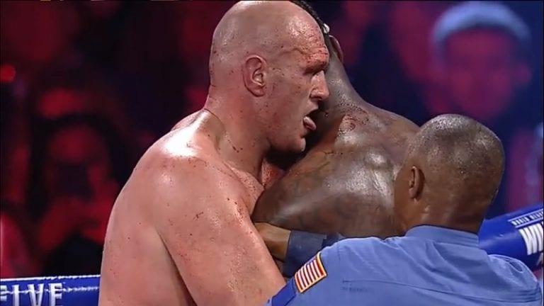 Video: Outo temppu mestaruusmatsin lopulla – Tyson Fury nuoli Deontay Wilderin veristä niskaa